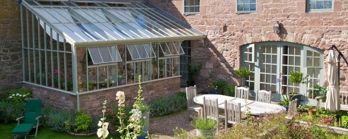 Hartley Botanic Architectural Range Glasshouse in a Garden.