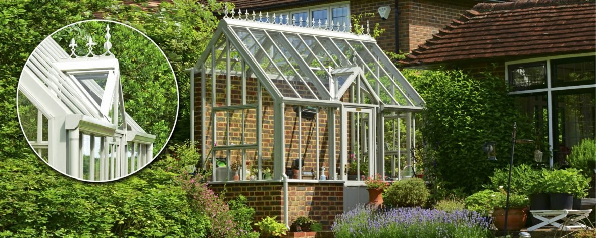 Entrance Roof Closeup of a White Hartley Botanic Bespoke Lean To Glasshouse With Brick Base.
