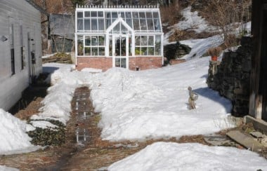 snow-covering-path-to-glasshouse