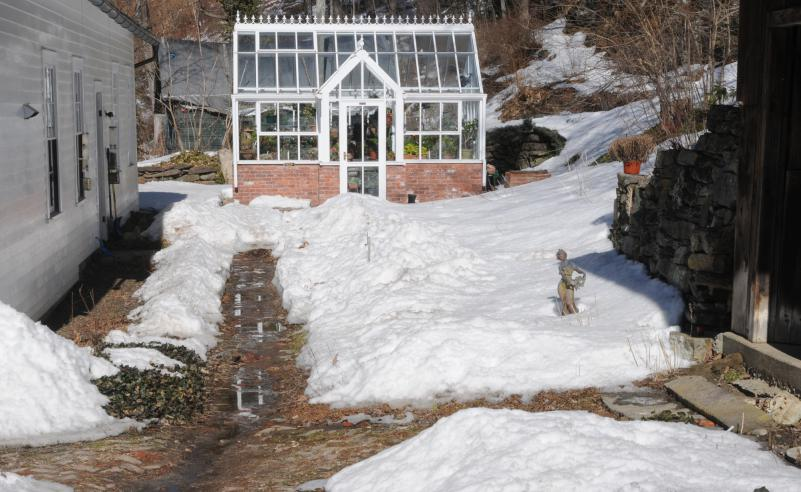winter scene with Hartley greenhouse in snow in MA