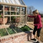 Michelle standing in front of cold frames